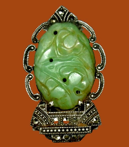 Green jade, sterling silver brooch. 1930s