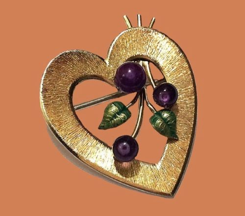 Heart brooch. jewelry alloy, gilding, colored enamel, glass beads. 1950s