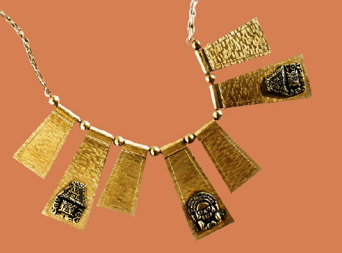 Inca Mystery Necklace. Jewelery alloy, 14 carat gold plating, texturing, black enamel. 1970s 21 cm