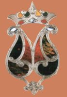 Inlaid with red, yellow, brown and blue agate brooch. 1850s 7 cm