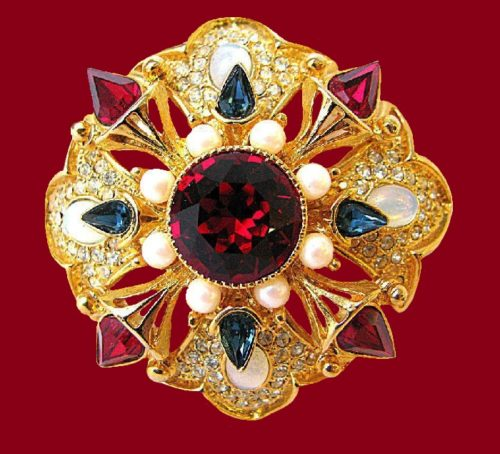 Maltese cross brooch. Artificial ruby, Swarovski crystals, jewelery alloy of gold tone. 4.2 x 6.4 cm. 1990s