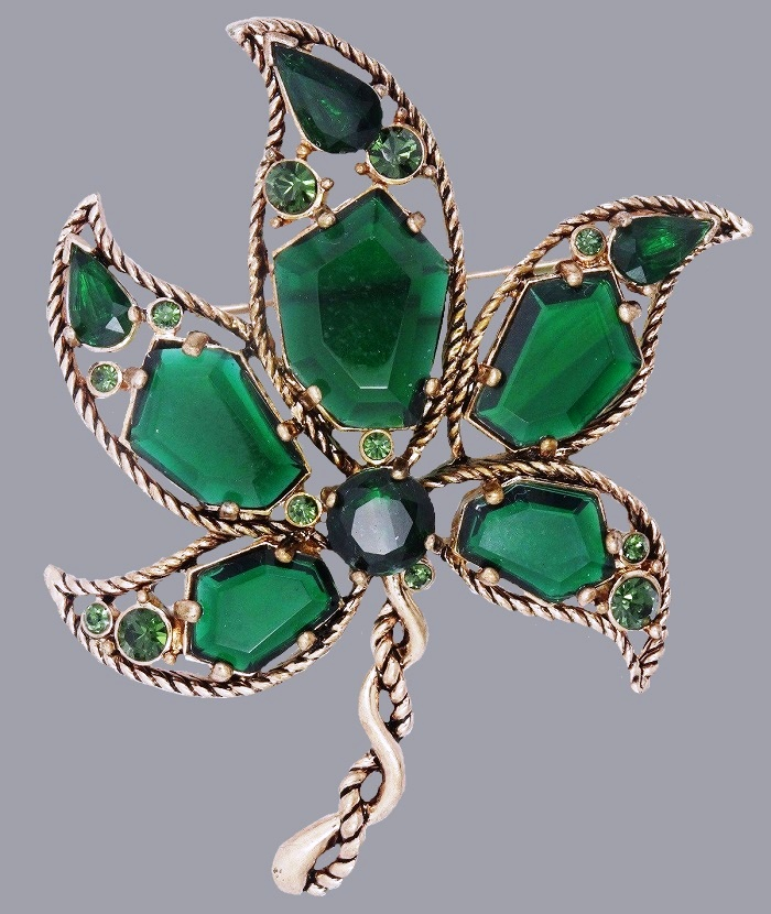 Maple leaf brooch. Silver tone metal, faux emeralds