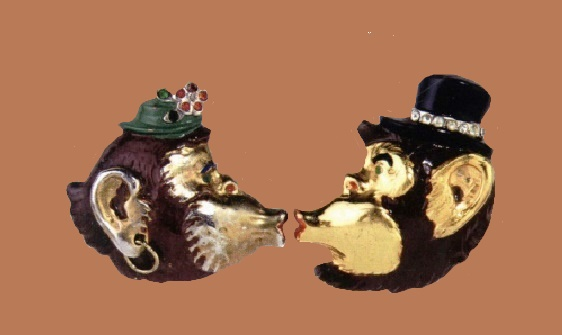 Mr. and Mrs. Gorilla. 1940. Gold plated metal pin clips, brown, green black and red enamel of two gorilla heads kissing male and female