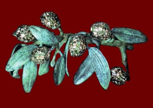 Olive branch brooch. Bronze patina silver, green sapphires, chrysoberyls, tourmalines. 1992