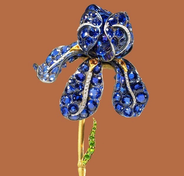 Orchid brooch. Gold, silver, sapphire, spinel, and diamond