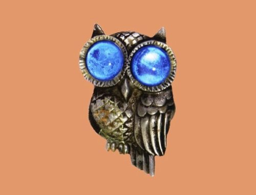 Owl brooch, 1940. Designer Victor Silson. Pot metal brooch with light blue lucite cabochons in the shape of an owl. 7.2x4.5cm