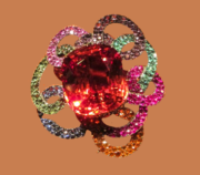 Poppy brooch, gold with tourmalines and diamonds. 1982. Effective combination of calibrated green and red tourmaline with a convex surface and a large brilliant cut diamonds