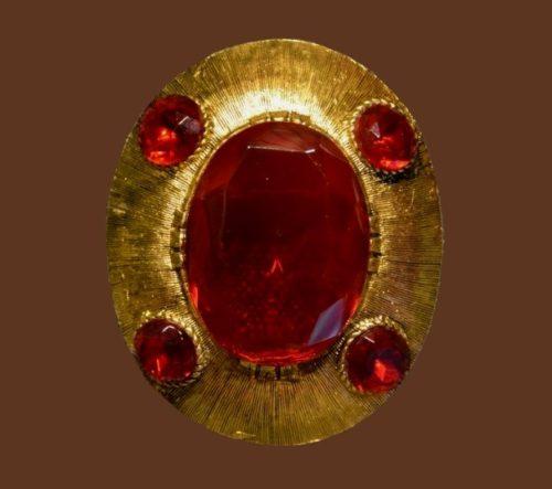 Red crystals gold tone metal oval brooch, vintage