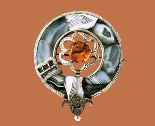 Silver brooch with marble agate and topaz. 1880s £ 500-800 LYNH