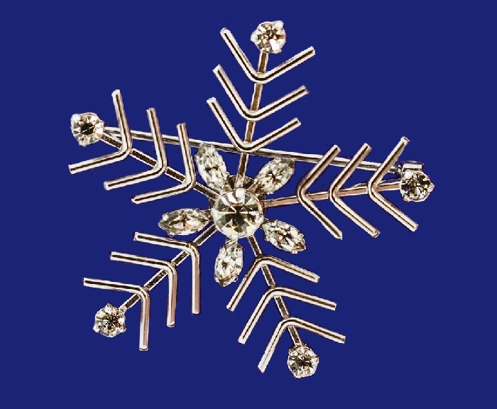 Snowflake brooch. Jewelry alloy, rhinestones, white gold. 1960s