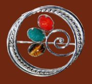 Sterling silver round brooch. Carved scarab beetle stones