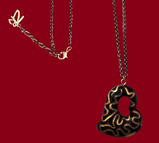 Stylish black and gold heart shaped pendant