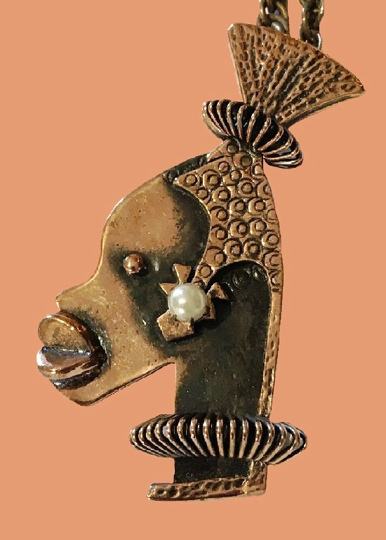 Ubangi Tribal face with pearl earring, copper brooch pendant