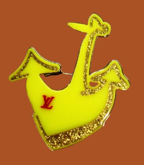 Anchor brooch. Yellow plastic, rhinestones, gold plated