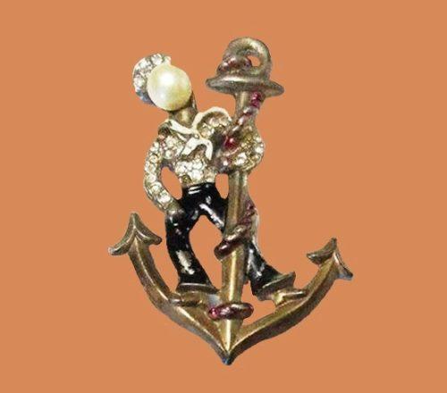 Anchor's away sailor figural brooch. 1940s. Gold tone metal, enamel, rhinestones. Designer Anne glass, bookpiece, patriotic jewelry