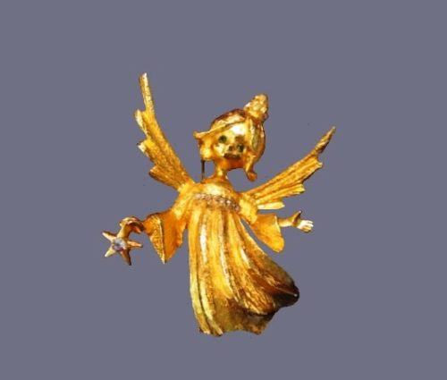 Angel with star. Brooch of jewelry alloy and rhinestones