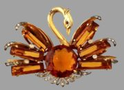 Beautiful swan brooch. Pinkey amber colored faceted crystal rhinestone, eye - amber cabochon