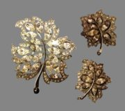 Beautifully crafted leaf motif set of brooch and earrings, executed with rhinestones and rhodium plating