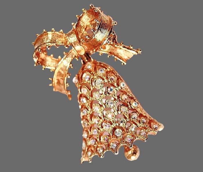 Bell with ribbon Christmas theme brooch. Aurora borealis rhinestones gold tone