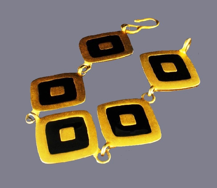 Black enamel, gold tone bracelet