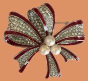 Bow vintage brooch. Metal, enamel, faux pearls, crystals. 6 cm