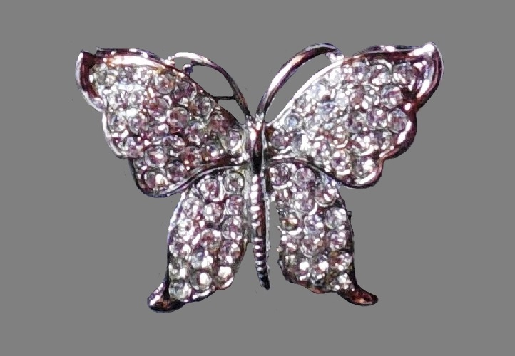 Butterfly brooch. Silver tone metal, crystals