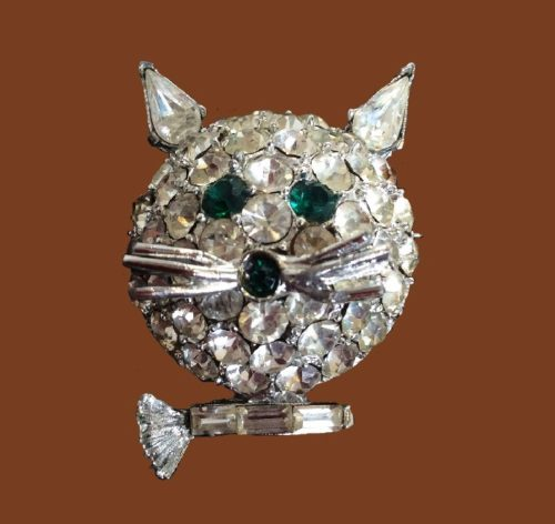 Cute cat's face brooch. Jewelry alloy, rhinestones. 3.5 cm. 1970s