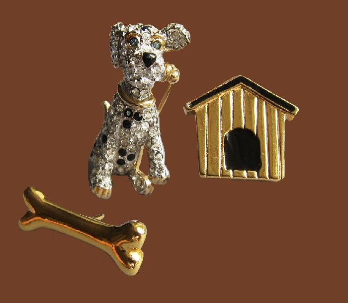 Dalmatian puppy with a house and a bone. 1980s brooch. Jewelery alloy of gold tone, Swarovski crystals, enamel. The house and the bone have a pin buckle