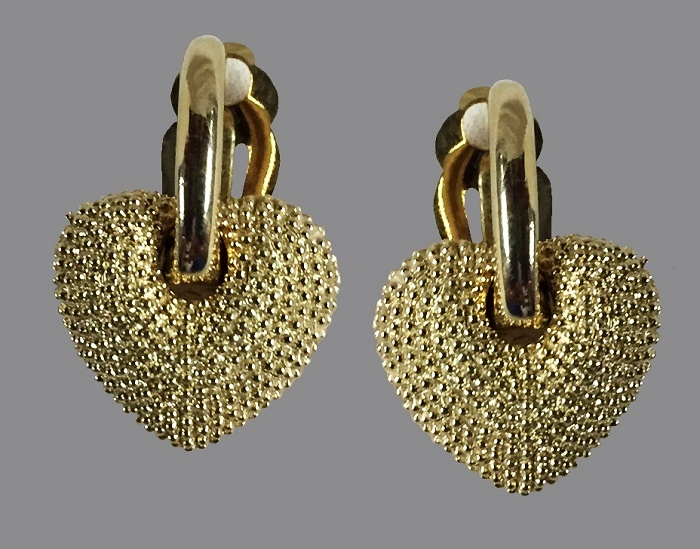 Dangle heart earrings. Gold tone metal