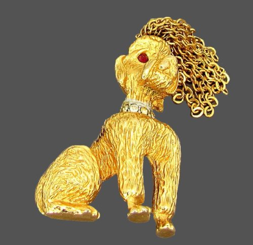 Dog vintage brooch from the series, which is the hallmark of the company and is always recognizable. Jewelery alloy gold tone with a textured surface, inlaid with crystals