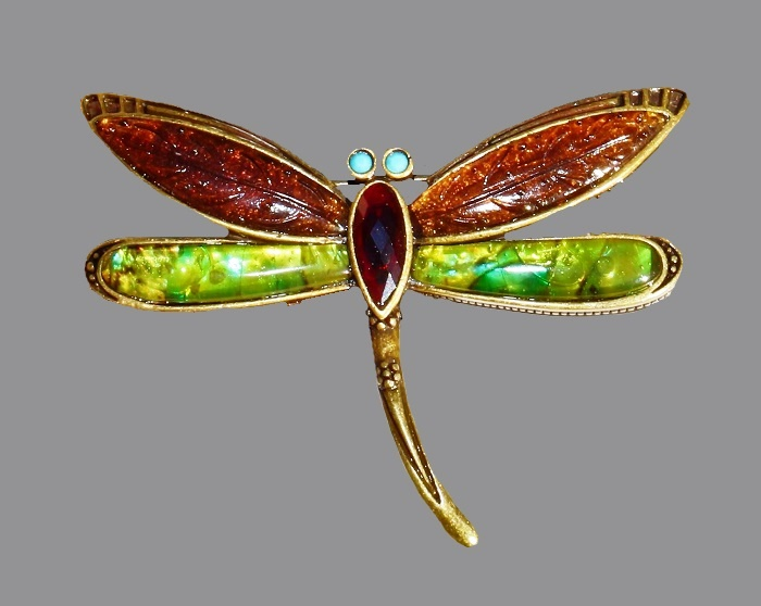 Dragonfly vintage brooch. Metal of bronze tone. Turquoise eyes, amber and green wings with a textured surface. 5.5 cm