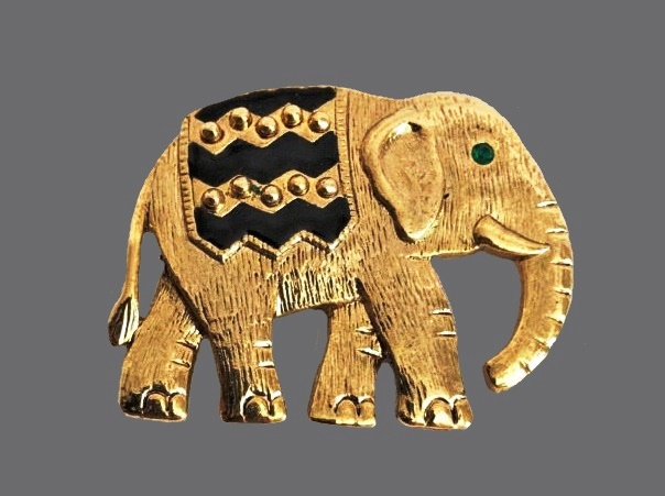 Elephant brooch of gold tone with rhinestones