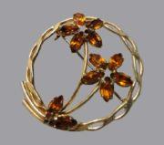 Floral design brooch. 1940s. 12 K Gold plated, crystals
