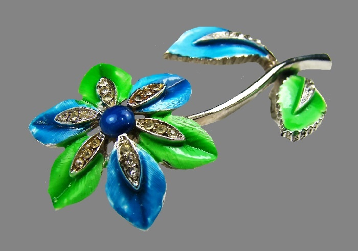 Flower brooch. Jewelry alloy, green and blue enamel, rhinestones. Robert Mandle
