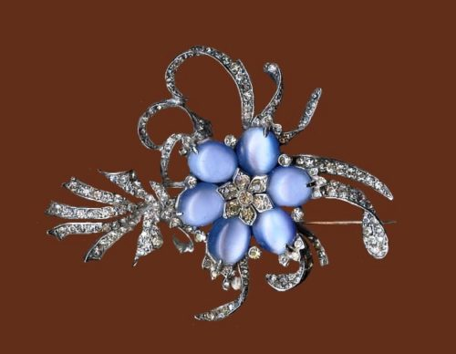 Flower brooch. Silver tone metal, blue glass moonstones, rhinestone