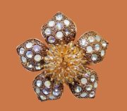 Flower textured brooch. Jewelry alloy of gold tone, rhinestones, crystals