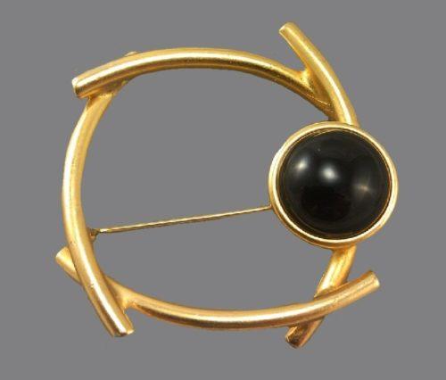 Geometric brooch. Jewelry alloy of gold tone, black cabochon, black glass. 4.8 cm