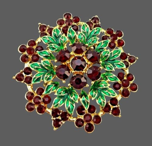 Green enameled and faux garnet flower brooch