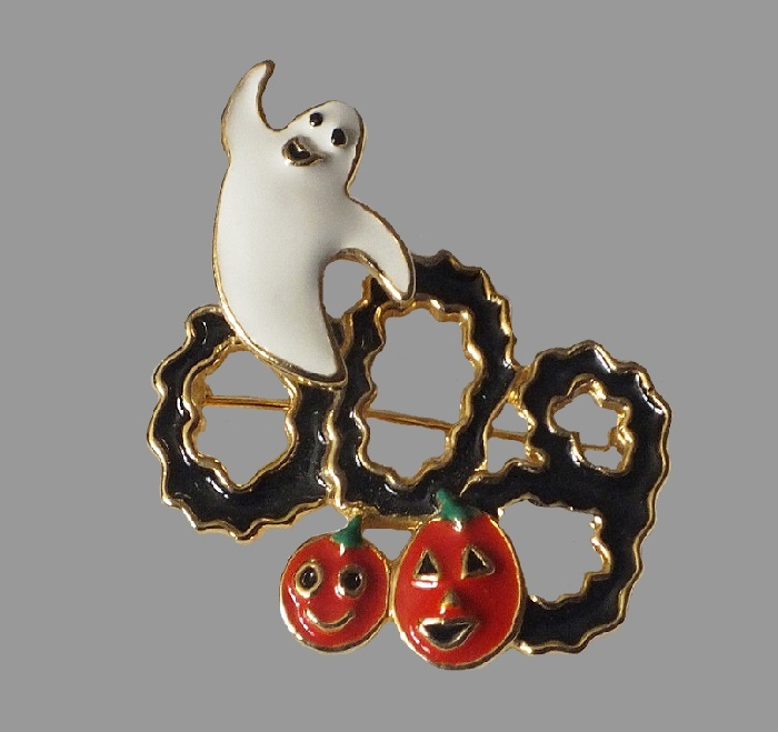 Halloween articulating ghost and pumpkins figurative brooch. Black orange and white enamel