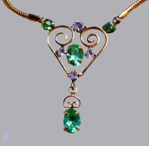 Heart drop dangle necklace of gold tone with rhinestones
