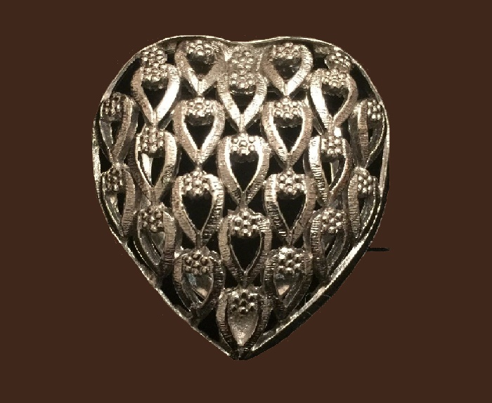 Heart shaped pin. Silver tone metal