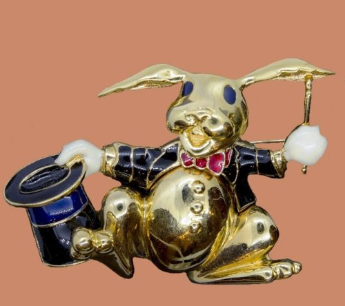 Labeled brooch 'Magic Rabbit'. Jewelery alloy, glossy surface, decorated with enamels of black, white, dark blue and scarlet colors. 1970s