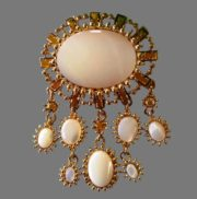 Large brooch-pendant with mother-of-pearl cabochons and crystals with a mirror coating of golden color. 7.5 x 5 cm