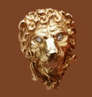 Lion's head gold tone vintage brooch. Made of jewelry alloy, decorated with crystals. 1970s
