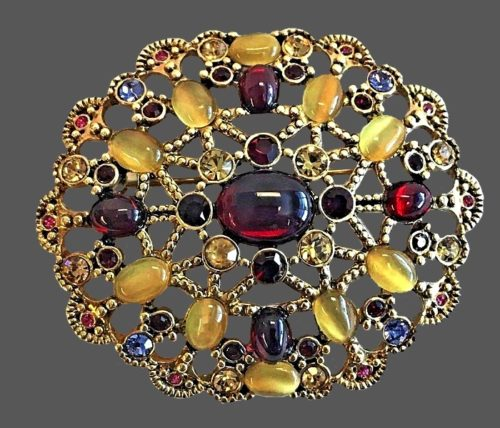 Multi color cabochons, rhinestones and crystals brooch of gold tone jewelry alloy
