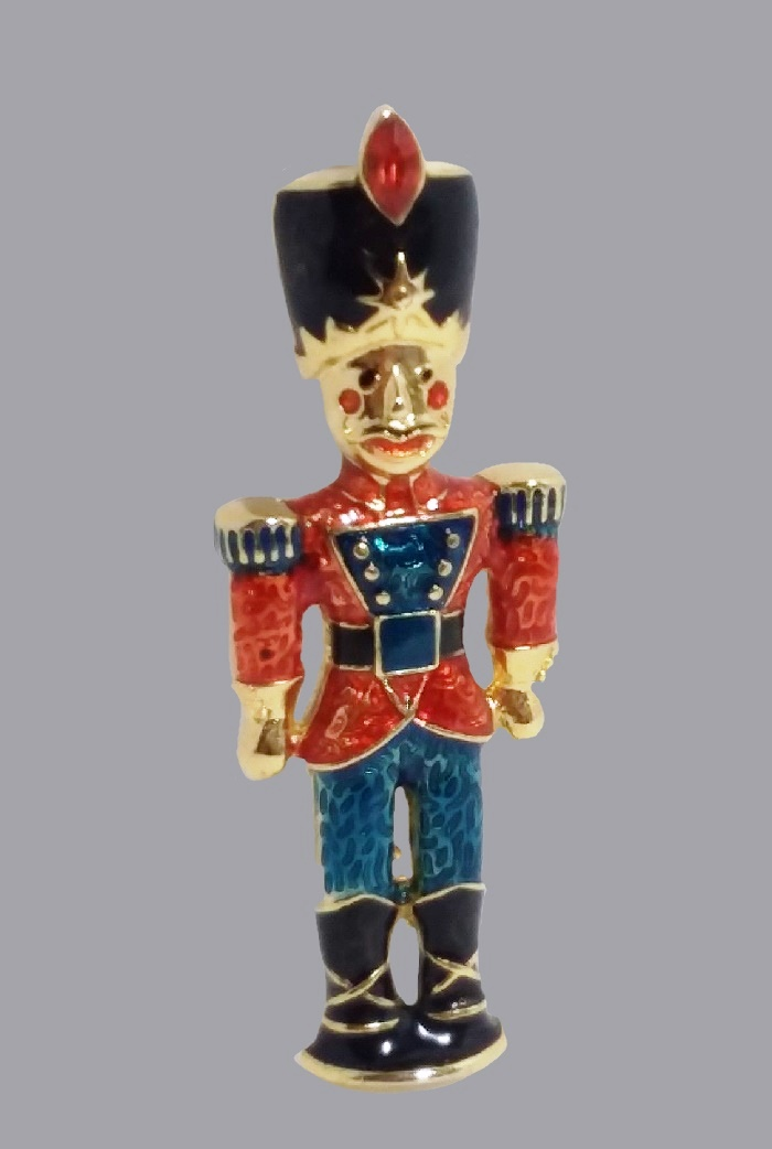 Nutcracker Christmas brooch. Jewelry alloy, enamel