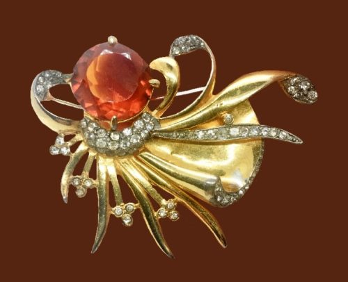 Octopus like amber glass and rhinestone brooch