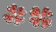 Pink clover brooch with heart shaped petals. Silver plated, rhinestone