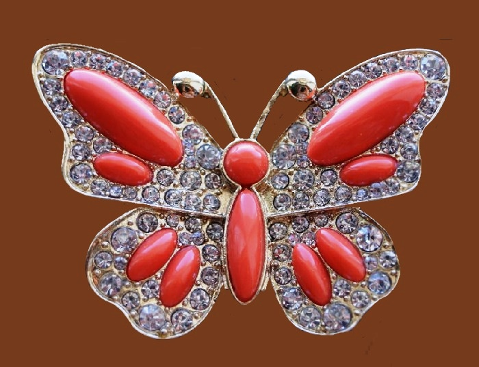 Red butterfly brooch. Metal of gold tone, inlaid with transparent rhinestones, cabochon of coral color. 6 cm