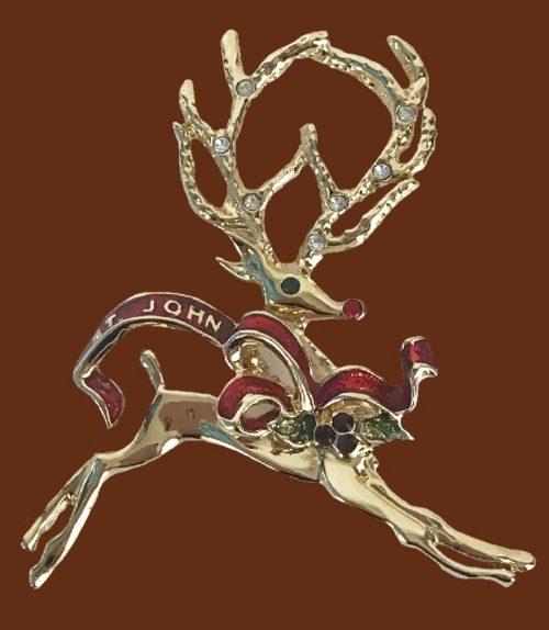 Reindeer Christmas enameled brooch of gold tone